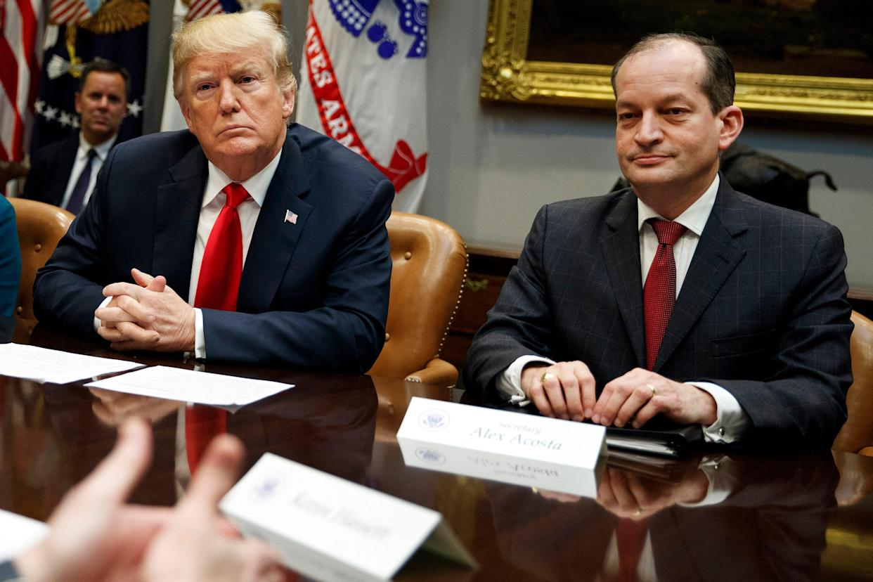 President Donald Trump, left, and Labor Secretary Alexander Acosta listen during a meeting of the President's National Council of the American Worker in the Roosevelt Room of the White House in Washington, Sept. 17, 2018.