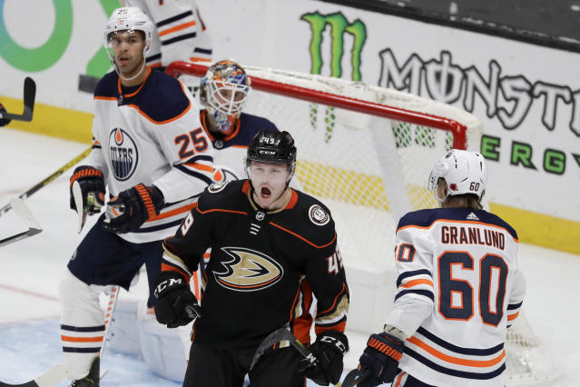Anaheim Ducks left wing Max Jones, middle, celebrates after scoring against the Edmonton Oilers during the third period of an NHL hockey game in Anaheim, Calif., Sunday, Nov. 10, 2019. (AP Photo/Chris Carlson)