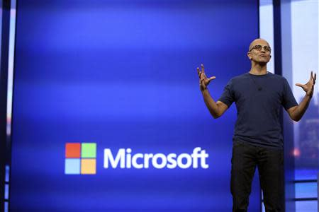 "Microsoft CEO Satya Nadella gestures as he speaks during his keynote address at the company's ""build"" conference in San Francisco, California April 2, 2014. REUTERS/Robert Galbraith"