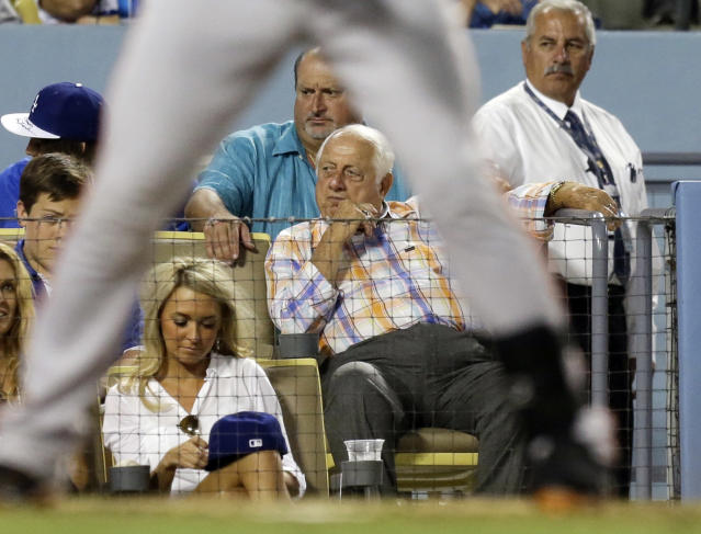 Former Los Angeles Dodgers manager Tommy Lasorda takes in the Dodgers' baseball game against theSan Francisco Giants in Los Angeles on Saturday, Sept. 14, 2013. (AP Photo/Reed Saxon)