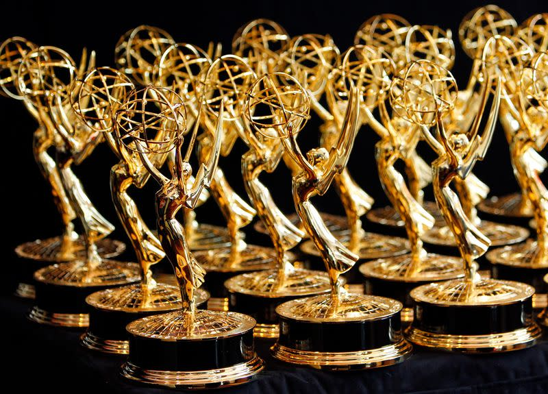 Dozens of Emmy Awards are lined up on the trophy table in the media center at the 62nd annual Primetime Emmy Awards in Los Angeles