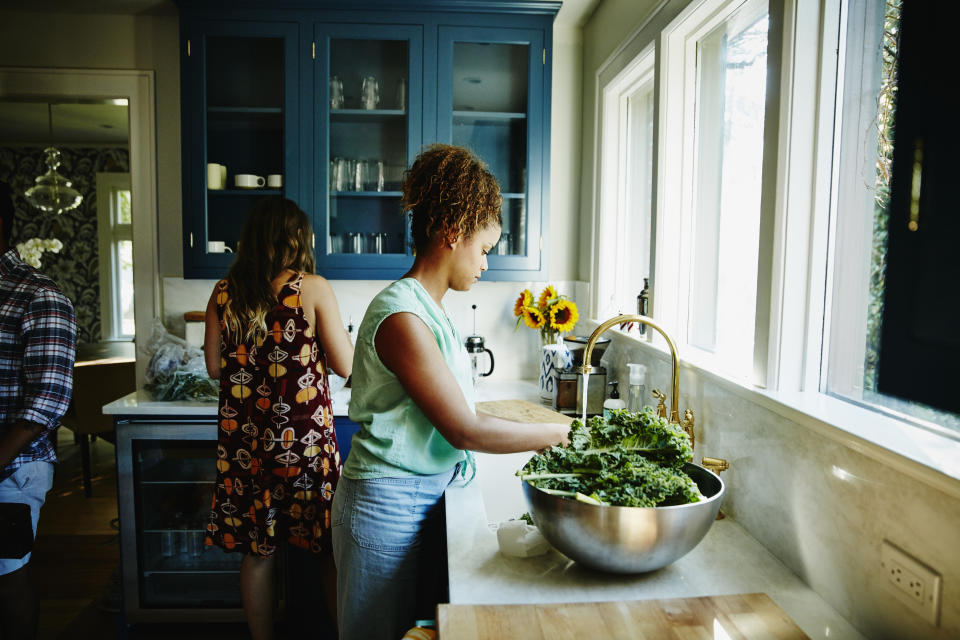 Friends preparing Juneteenth meal. (Getty Images)