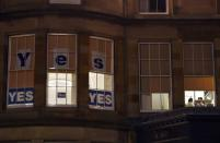 "Pro-Scottish independence ""Yes"" signs are seen displayed in an office's windows in central Edinburgh, Scotland September 12, 2014. REUTERS/Dylan Martinez"