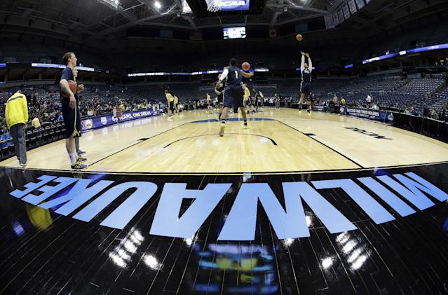 Michigan players warm up during a practice session for their NCAA college basketball tournament game Wednesday, March 19, 2014, in Milwaukee. Michigan plays Wofford on Thursday. (AP Photo/Morry Gash)