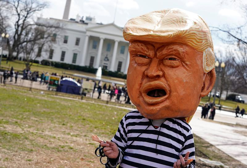 An impersonator of U.S. President Donald Trump stands in front of the White House during a demonstration against Trump on President's Day in Washington, Feb. 18, 2019. (Photo: Joshua Roberts/Reuters)