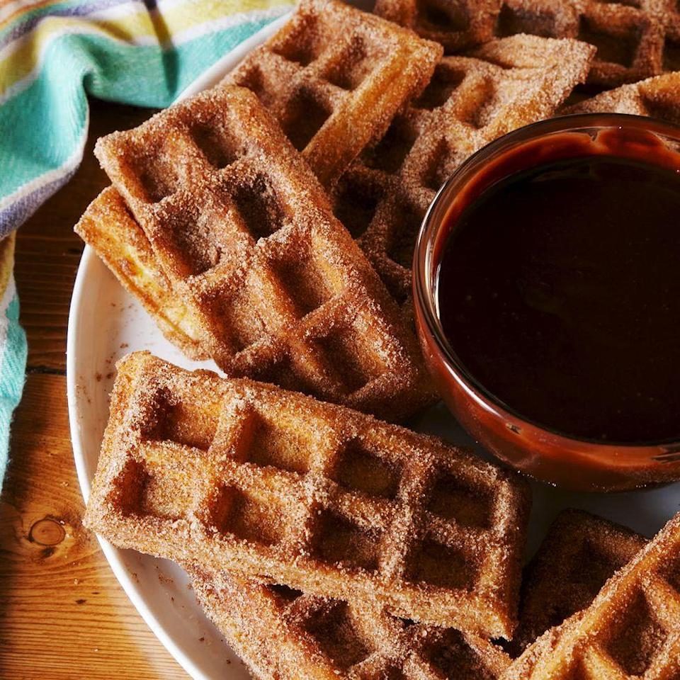 """<p>If you're short on time, you could skip the batter-making steps and just use a boxed mix. But let it be known that this recipe guarantees fluffy-on-the-inside, crispy-on-the-outside waffles. It's the best. </p><p>Get the <a href=""""https://www.delish.com/uk/cooking/recipes/a29261112/best-churro-waffle-dippers-recipe/"""" rel=""""nofollow noopener"""" target=""""_blank"""" data-ylk=""""slk:Churro Waffle Dippers"""" class=""""link rapid-noclick-resp"""">Churro Waffle Dippers</a> recipe.</p>"""
