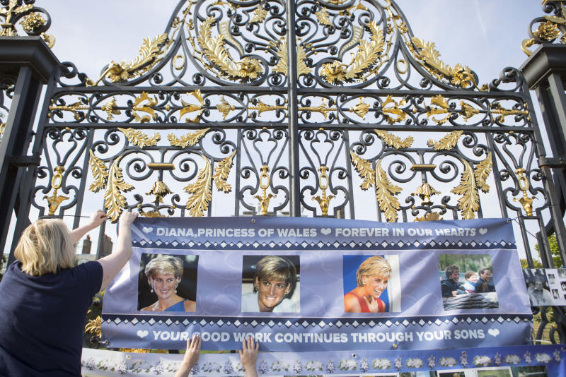Posters of Diana, Princess of Wales are placed on the gates of Kensington Palace as the anniversary of her death falls on Saturday. Photo: Rick Findler/PA Wire