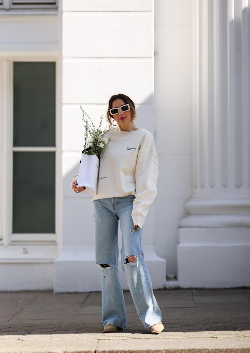 <p>Channel laidback '90s style with a sweatshirt and flats.</p>