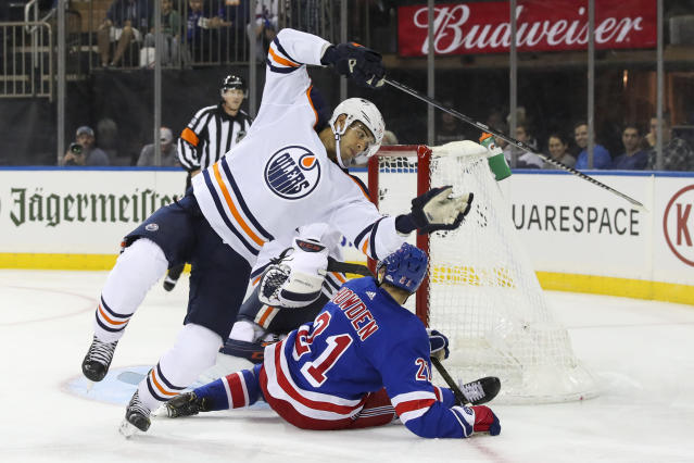 Edmonton Oilers defenseman Darnell Nurse trips over New York Rangers center Brett Howden (21) during the second period of an NHL hockey game, Saturday, Oct. 12, 2019, at Madison Square Garden in New York. (AP Photo/Mary Altaffer)