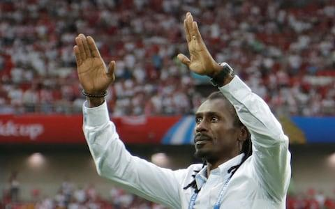 Senegal's head coach Aliou Cisse celebrates as his team won the group H match between Poland and Senegal - Senegal coach Aliou Cisse played in the country's 2002 World Cup team, where they reached the quarter-finals - Credit: AP