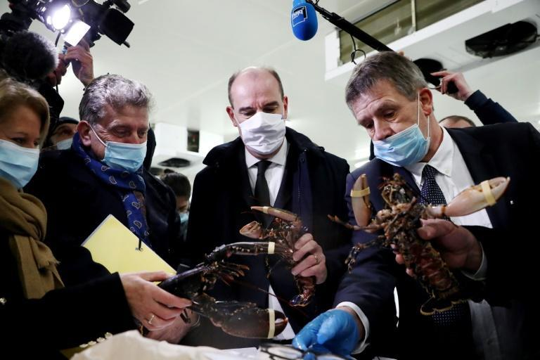 French Prime Minister Jean Castex (C) visited fishermen on Thursday, underscoring the sector's importance in Brexit talks