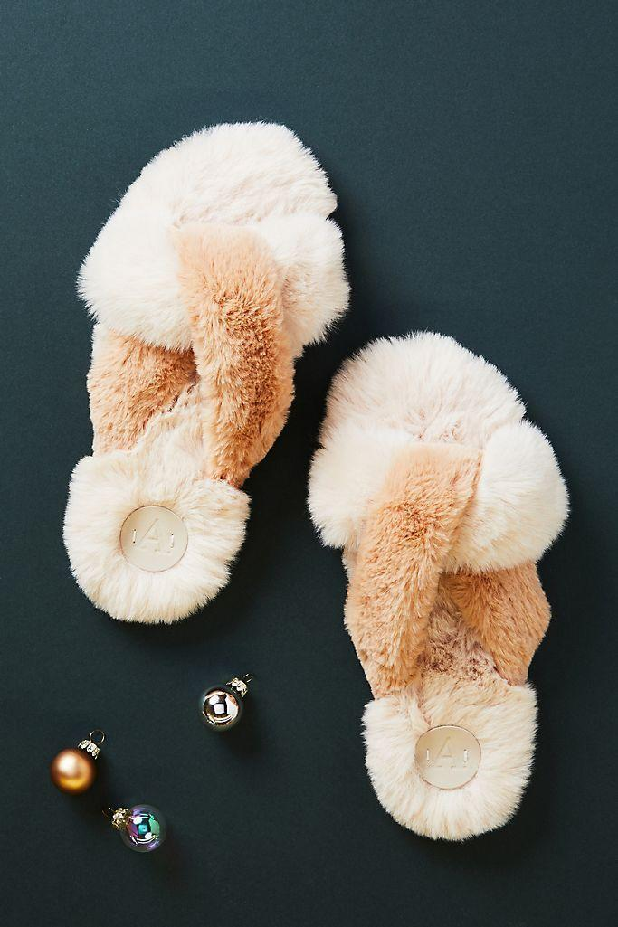 """<p><strong>Anthropologie</strong></p><p>anthropologie.com</p><p><strong>$38.00</strong></p><p><a href=""""https://go.redirectingat.com?id=74968X1596630&url=https%3A%2F%2Fwww.anthropologie.com%2Fshop%2Flexie-slippers&sref=https%3A%2F%2Fwww.housebeautiful.com%2Fentertaining%2Fholidays-celebrations%2Fg34836475%2Fgifts-for-sisters%2F"""" rel=""""nofollow noopener"""" target=""""_blank"""" data-ylk=""""slk:Shop Now"""" class=""""link rapid-noclick-resp"""">Shop Now</a></p>"""