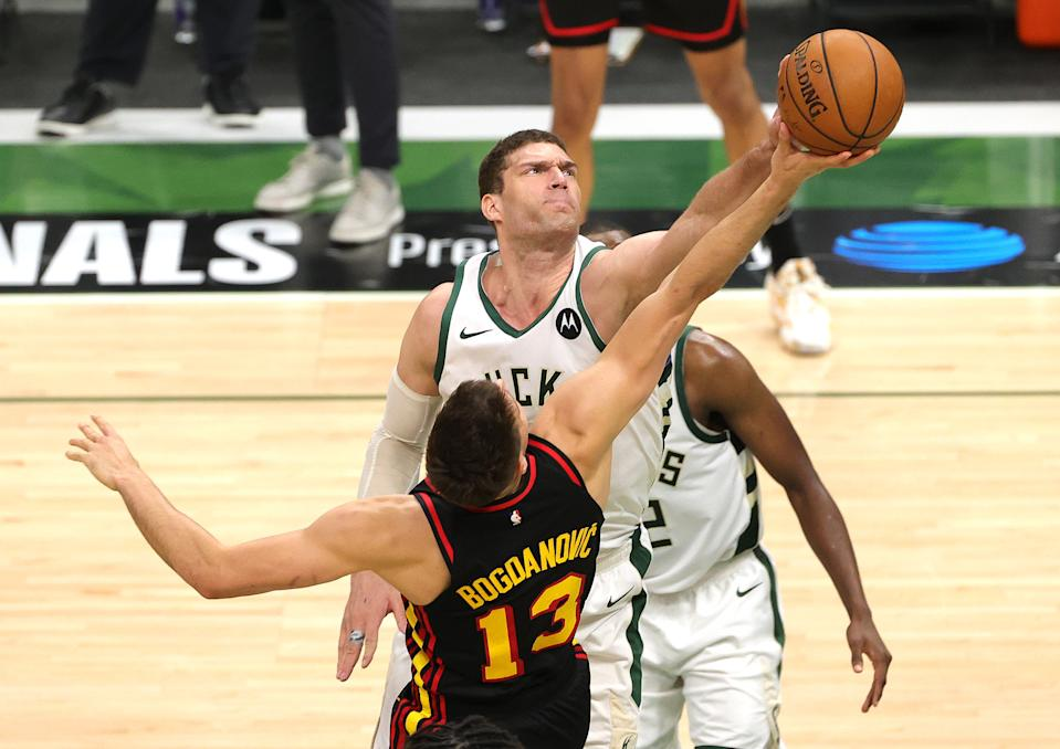 MILWAUKEE, WISCONSIN - JULY 01: Brook Lopez #11 of the Milwaukee Bucks blocks a  during the second half in Game Five of the Eastern Conference Finals at Fiserv Forum on July 01, 2021 in Milwaukee, Wisconsin. NOTE TO USER: User expressly acknowledges and agrees that, by downloading and or using this photograph, User is consenting to the terms and conditions of the Getty Images License Agreement. (Photo by Stacy Revere/Getty Images)