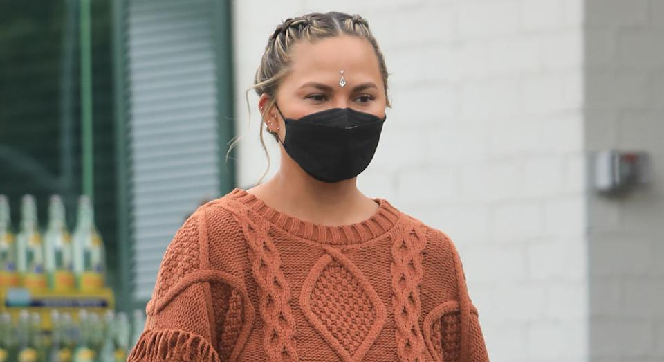 Chrissy Teigen has put together a collection of face masks over the last few months.  (Getty Images)