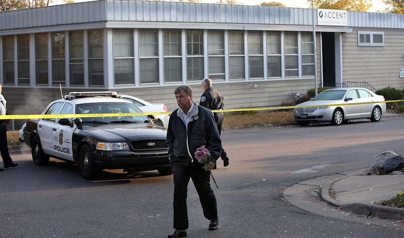 Jim Dow, who said he had been a vendor who had known Reuven Rahamim, the owner of the business, for more than 20 years, drops by Accent Signage Systems Inc., to place flowers at the scene, Friday, Sept. 28, 2012, where a gunman killed four people inside the Minneapolis sign company a day earlier. (AP Photo/Star Tribune, Jim Gehrz) MANDATORY CREDIT; ST. PAUL PIONEER PRESS OUT; MAGS OUT; TWIN CITIES TV OUT