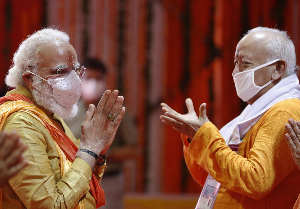 Indian Prime Minister Narendra Modi performs rituals during the groundbreaking ceremony of a temple dedicated to the Hindu god Ram, in Ayodhya, India, Wednesday, Aug. 5, 2020.