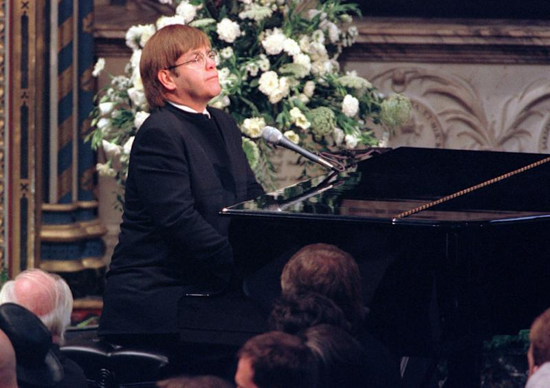 "** FILE ** Elton John plays a specially re-written version of his song ""Candle in the Wind"" during the funeral service for Diana, Princess of Wales at London's Westminster Abbey in this Saturday, Sept. 6, 1997 file photo. (AP Photo/Paul Hackett, Pool)"