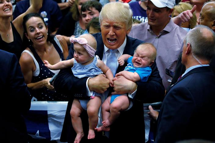 <p>JUL. 29, 2016 — Republican presidential nominee Donald Trump holds babies at a campaign rally in Colorado Springs, Colorado. (Carlo Allegri/Reuters) </p>