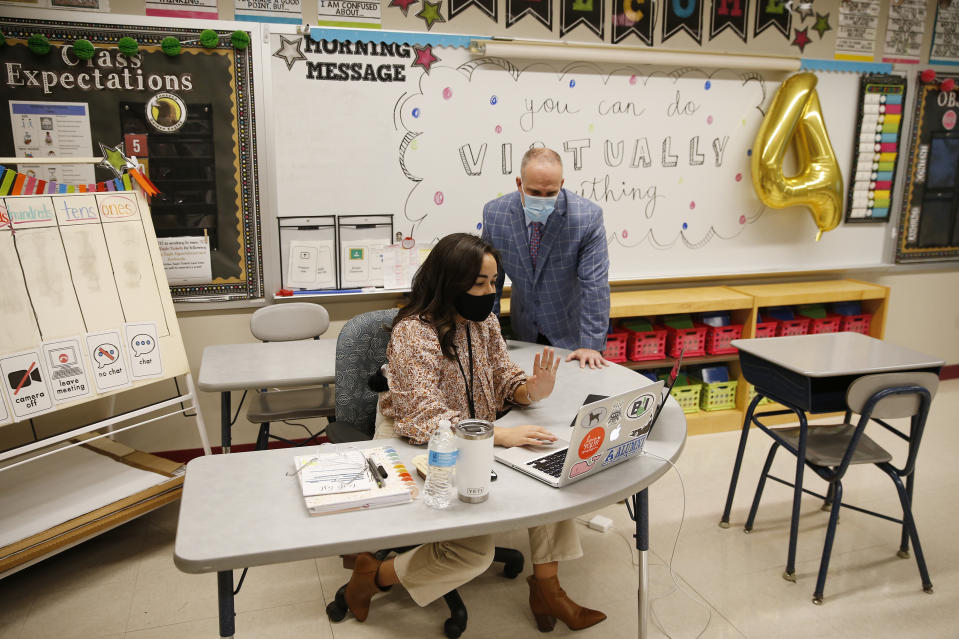 Superintendent Matt Malone watches fourth-grade teacher Amber Moukhtarian instruct her students via Zoom at Mary L. Fonseca Elementary School in Massachusetts.