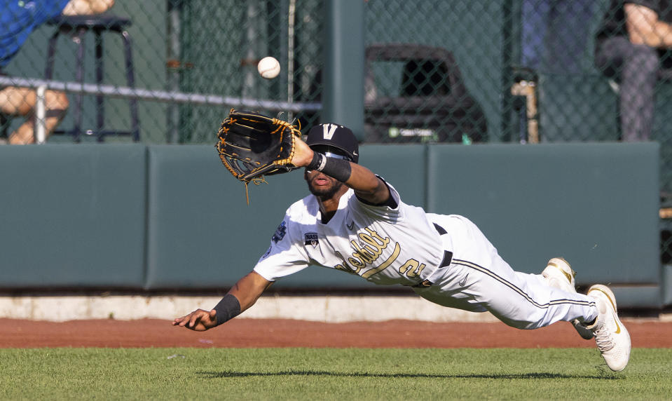 Vanderbilt's Javier Vaz (2) dives to catch a ball hit by Stanford's Eddie Park to close out the second inning during a baseball game in the College World Series Wednesday, June 23, 2021, at TD Ameritrade Park in Omaha, Neb. (AP Photo/Rebecca S. Gratz)
