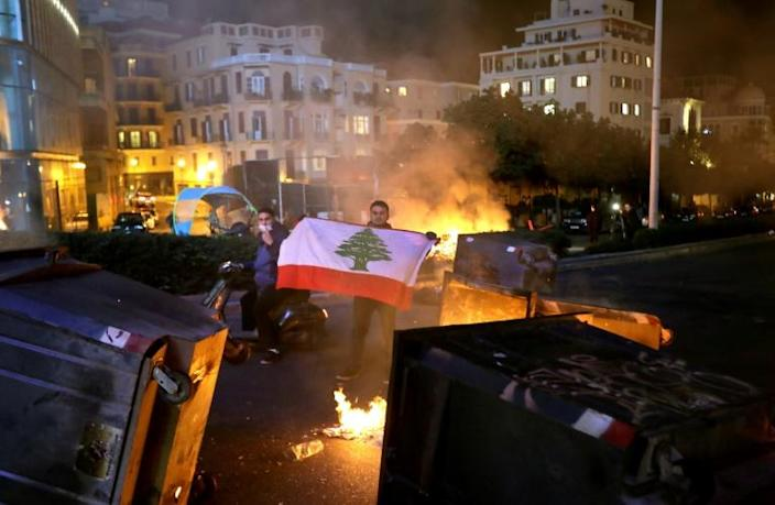 Lebanese anti-government protesters set fires and blocked central Beirut thoroughfares again on Wednesday (AFP Photo/JOSEPH EID)
