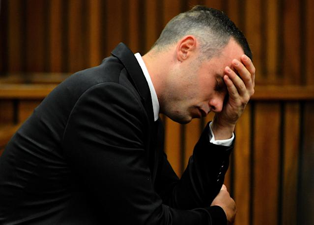 Oscar Pistorius, cradles his head in his hands during court proceedings in Pretoria, South Africa, Monday, May 5, 2014, at the resumption of his murder trial, following a two week break. Pistorius is charged with the shooting death of his girlfriend Reeva Steenkamp on Valentine's Day in 2013. (AP Photo. (AP Photo/Thobile Mathonsi, Pool)