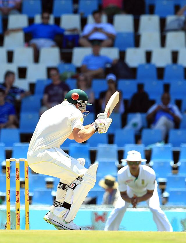Australia's Shaun Marsh ducks under a bouncer from South Africa's Morne Morkel, on the first day of their their cricket Test match at Centurion Park in Pretoria, South Africa, Wednesday, Feb. 12, 2014. (AP Photo/ Themba Hadebe)