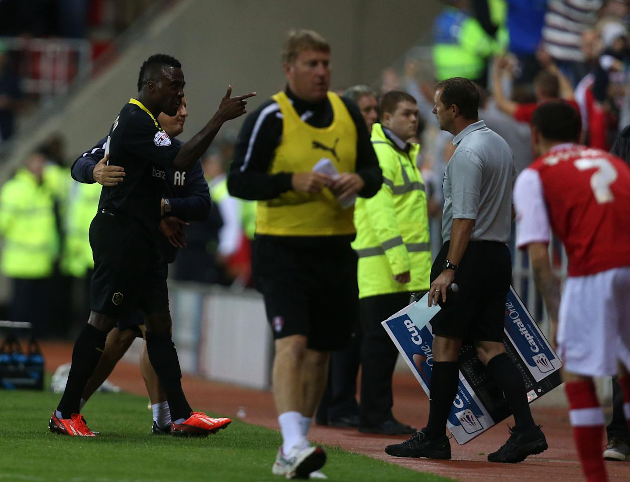 Sheffield Wednesday's Jermaine Johnson is sent off after the Referee, D Drysdale consulted with the fourth official N Murphy during the Capital One Cup, First Round match at the New York Stadium, Rotherham.
