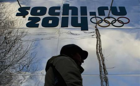 A man walks past a shop with an Olympic logo in the Black Sea resort town of Sochi December 21, 2013. REUTERS/Maxim Shemetov