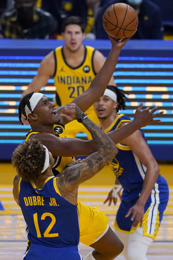 Indiana Pacers center Myles Turner, middle left, shoots next to Golden State Warriors guard Kelly Oubre Jr. (12) during the first half of an NBA basketball game in San Francisco, Tuesday, Jan. 12, 2021. (AP Photo/Jeff Chiu)