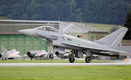 """FILE PHOTO: The first Austrian military jet fighter """"Eurofighter Typhoon"""" lands on the military airport in the small Styrian village of Zeltweg, Austria, July 12, 2007.  REUTERS/Leonhard Foeger/File Photo"""