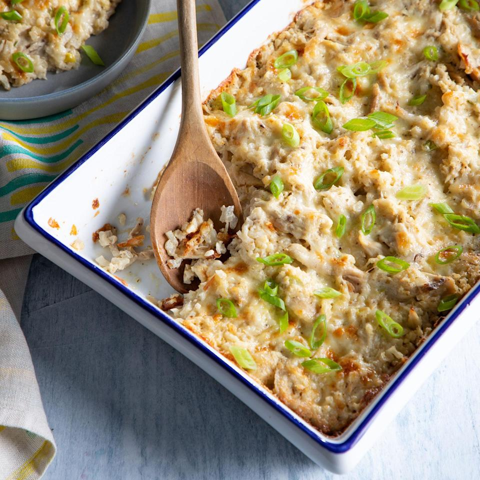 """<p>Get your veggies and your protein fix in this easy, gluten-free chicken and cauliflower-rice casserole. Riced cauliflower stands in for traditional rice, making this creamy casserole low in carbs but—with the simple combination of Cheddar cheese and chicken—suitable for even the pickiest of eaters. <a href=""""https://www.eatingwell.com/recipe/7883913/chicken-cauliflower-rice-casserole/"""" rel=""""nofollow noopener"""" target=""""_blank"""" data-ylk=""""slk:View recipe"""" class=""""link rapid-noclick-resp""""> View recipe </a></p>"""