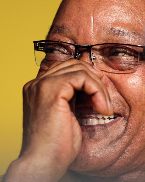 The ruling party African National Congress (ANC) president Jacob Zuma reacts during the opening of their elective conference at the University of the Free State in Bloemfontein, South Africa, on Sunday, Dec. 16, 2012. Zuma acknowledged Sunday that corruption and violence have marred the image of his African National Congress as it changed from a liberation movement to governing party, but called on members to again support him to be its leader. (AP Photo/Themba Hadebe)