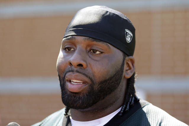 FILE - In this June 4, 2013, file photo, Philadelphia Eagles offensive tackle Jason Peters speaks with members of the media after NFL football practice at the team's training facility in Philadelphia. Peters has agreed to a five-year contract with the Eagles. Peters was signed for 2014 and his new deal adds four years through 2018. The 32-year-old Peters is a six-time Pro Bowl pick and two-time All-Pro. (AP Photo/Matt Rourke, File)