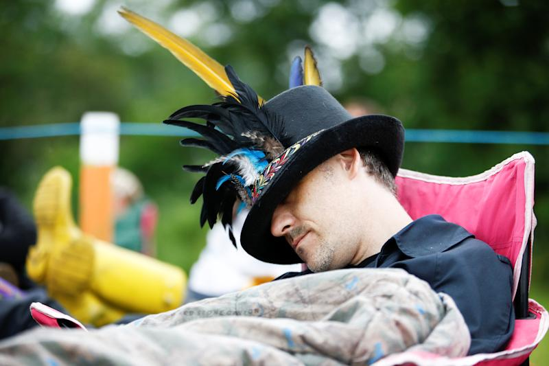 A man sleeps in a queue for Glastonbury Festival at Worthy farm in Somerset, Britain June 26, 2019. REUTERS/Henry Nicholls