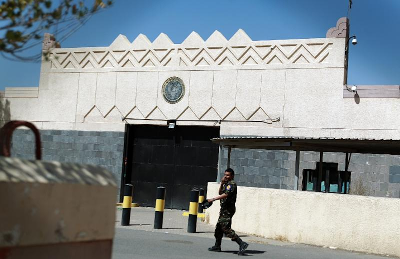 A Yemeni seucrity guard walks past the compound of the US embassy in Sanaa (AFP Photo/Mohammed Huwais)
