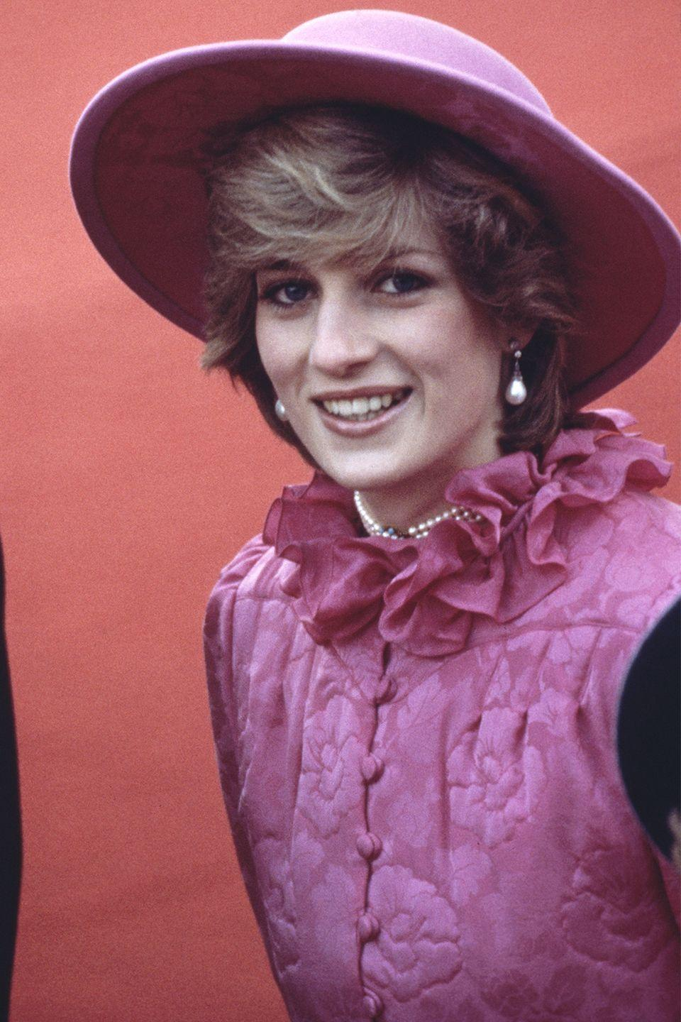 <p>The royal still managed to let her hair shine underneath a pink wide-brimmed hat at an event. </p>