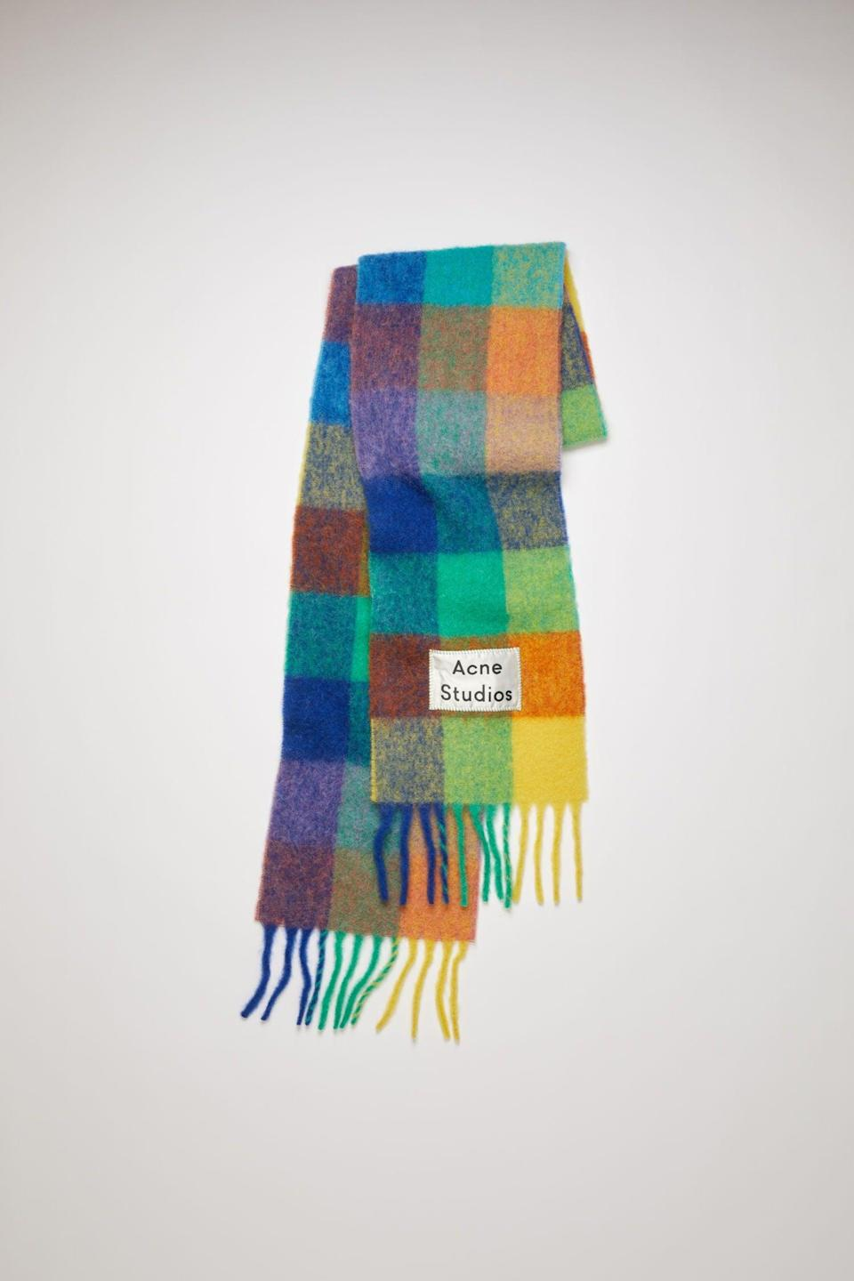 "It's probably super basic of me but I have wanted an Acne Studios scarf forever. Every person I have ever seen wearing an Acne scarf looks like they have their shit together, and I just want to be part of their world. In light of this, I'm putting this checkered <em>Elmer</em>-inspired number at the top of my autumn wish list. <br><br><strong>Acne Studios</strong> Multi Check Scarf, $, available at <a href=""https://www.acnestudios.com/uk/en/multi-check-scarf-blue-orange-green/CA0023-BOA.html"" rel=""nofollow noopener"" target=""_blank"" data-ylk=""slk:Acne Studios"" class=""link rapid-noclick-resp"">Acne Studios</a>"