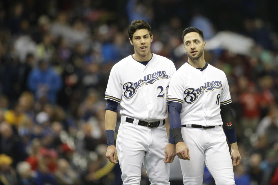 Milwaukee Brewers' Christian Yelich talks with Ryan Braun during the fourth inning of a baseball game against the Washington Nationals Wednesday, May 8, 2019, in Milwaukee. (AP Photo/Aaron Gash)