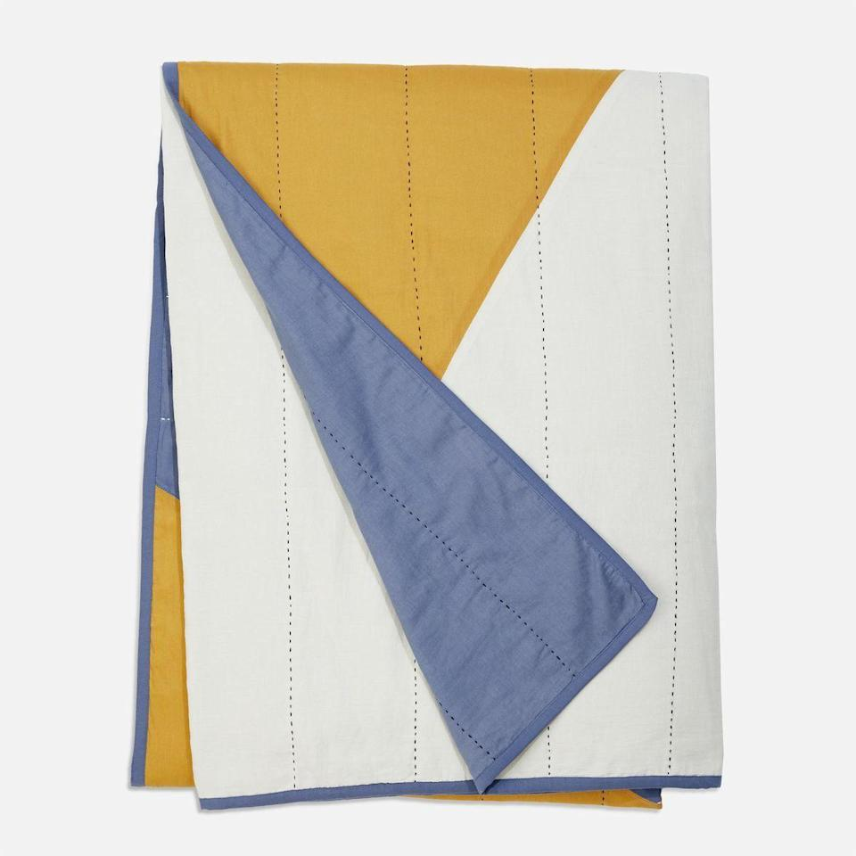 """<p><strong>Brooklinen</strong></p><p>brooklinen.com</p><p><a href=""""https://go.redirectingat.com?id=74968X1596630&url=https%3A%2F%2Fwww.brooklinen.com%2Fproducts%2Fanchal-patchwork-throw&sref=https%3A%2F%2Fwww.housebeautiful.com%2Fshopping%2Fbest-stores%2Fg35154173%2Fbrooklinen-surprise-sale-january-2021%2F"""" rel=""""nofollow noopener"""" target=""""_blank"""" data-ylk=""""slk:Shop Now"""" class=""""link rapid-noclick-resp"""">Shop Now</a></p><p><strong><del>$199</del> $169.15 (15% off)</strong></p><p>With a cool, color-blocked pattern, this quilt is the perfect finishing touch to your bed.</p>"""