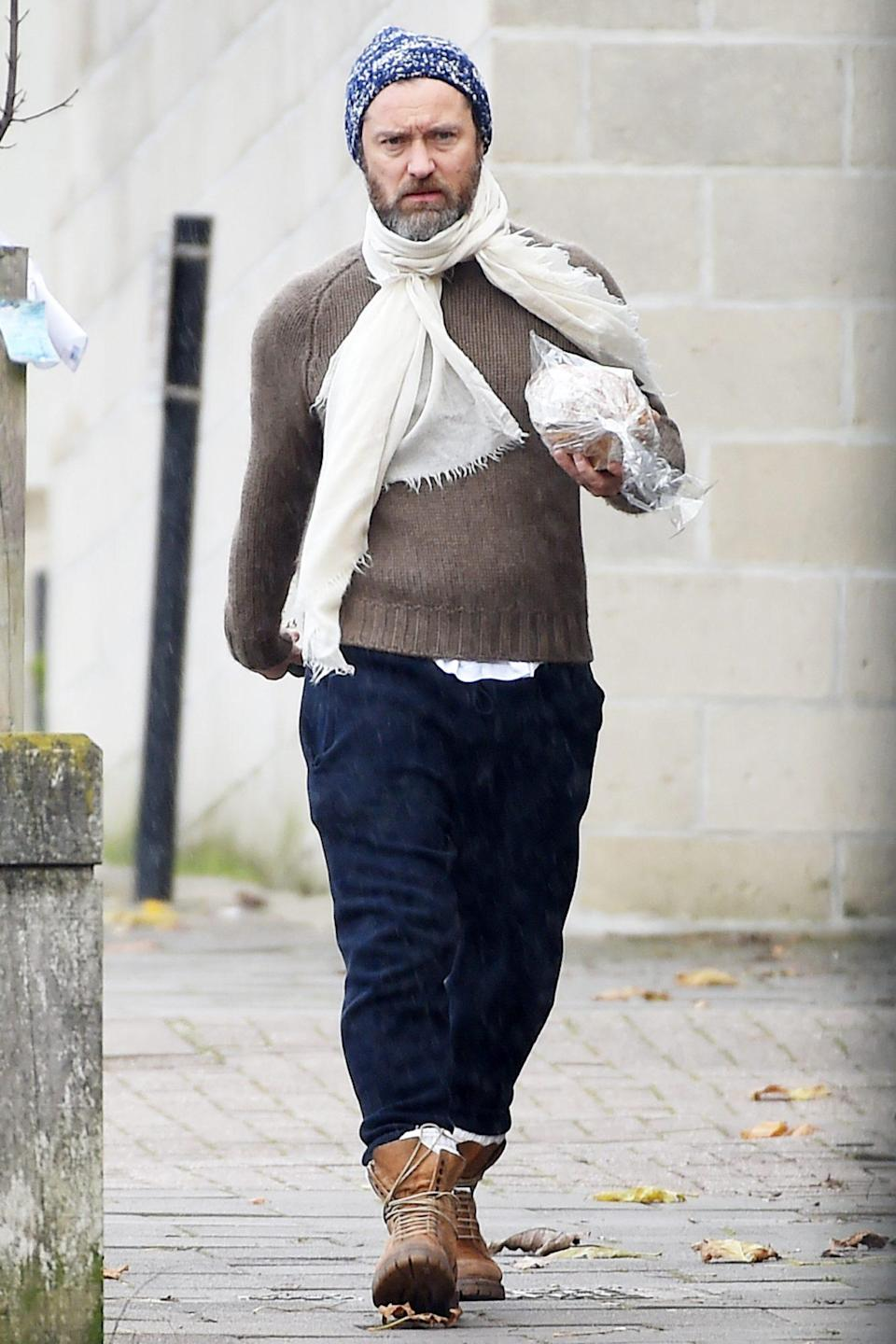 <p>Jude Law pops out to pick up some fresh bread on Wednesday in London.</p>