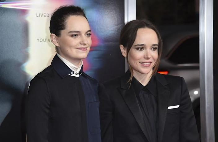 "FILE - Emma Portner, left, and Ellen Page arrive at the world premiere of ""Flatliners"" on Sept. 27, 2017, in Los Angeles. Page and Portner say they are divorcing after three years of marriage. In a statement Tuesday, Jan. 26, 2021, the couple said ""we have made the difficult decision to divorce following our separation last summer."" Portner was vocal in her support of Page when he came out as transgender in December, an announcement greeted as a watershed moment for the trans community in Hollywood. (Photo by Richard Shotwell/Invision/AP, File)"