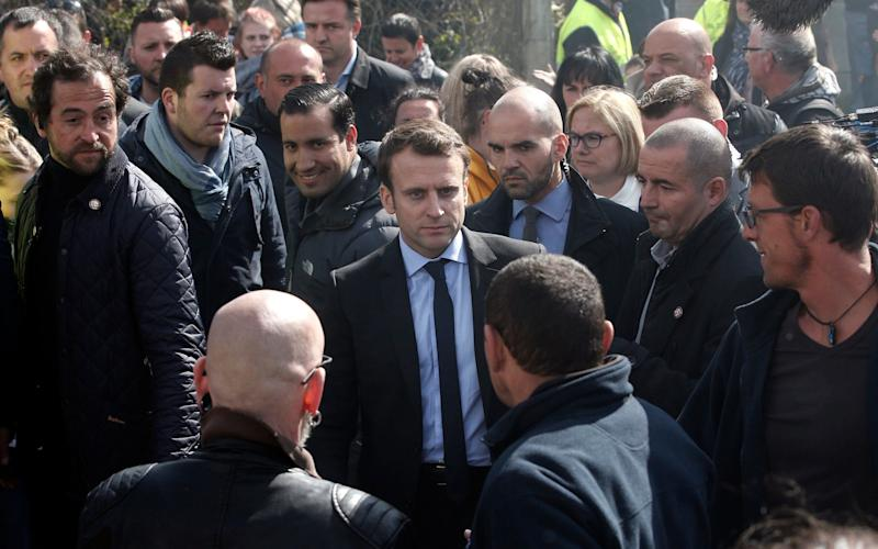 Macron was given a hostile reception by factory workers - Credit: AP Photo/Thibault Camus