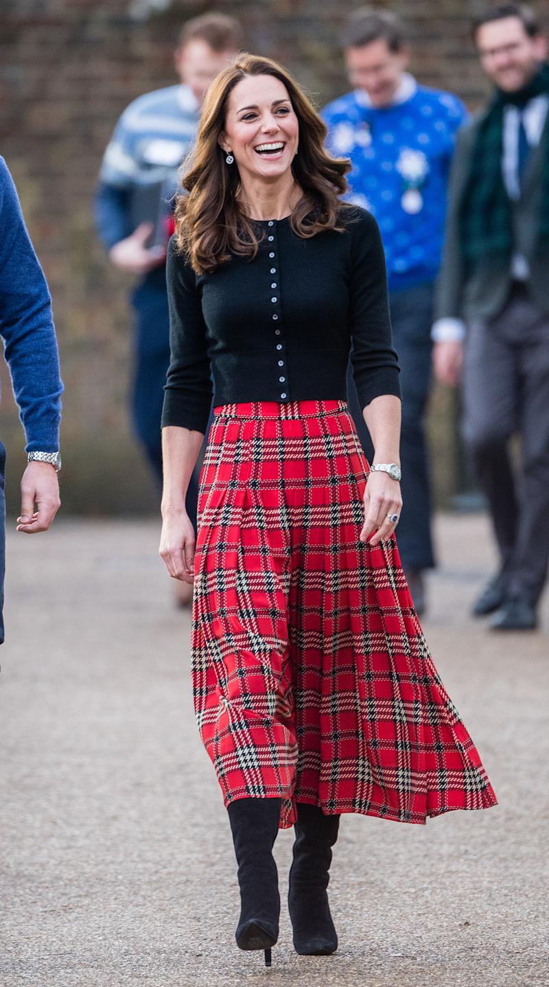 Kate wore a similar tartan Emilia Wickstead skirt while hosting a Christmas party for military personnel and their families last December. [Photo: Getty]