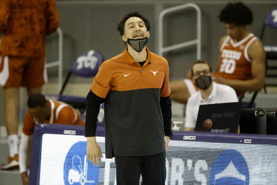 Texas head coach Shaka Smart directs his team against TCU during the first half of an NCAA college basketball game in Fort Worth, Texas, Sunday, March 7, 2021. (AP Photo/Michael Ainsworth)