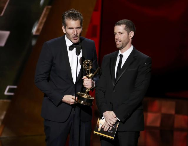 David Benioff, left, and D.B. Weiss accept the award for Outstanding Writing for a Drama Series for HBO's <em>Game of Thrones</em> at the 67th Primetime Emmy Awards. (Photo: Reuters/Lucy Nicholson)