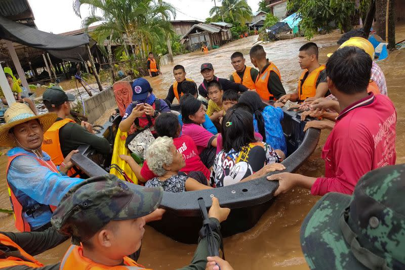 Soldiers evacuate villagers affected by heavy rain at Muang district in Loei province