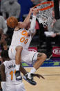 Orlando Magic forward Aaron Gordon (00) hangs on the rim after an unsuccessful dunk during the third quarter of an NBA basketball game, Monday, Jan. 18, 2021, in New York. (AP Photo/Kathy Willens, Pool)