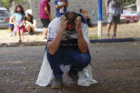 A fan mourns the death of Diego Maradona outside the stadium of the soccer club Gimnasia y Esgrima, coached by Maradona, in La Plata, Argentina, Wednesday, Nov. 25, 2020. The Argentine soccer great who was among the best players ever and who led his country to the 1986 World Cup title before later struggling with cocaine use and obesity, died from a heart attack on Wednesday at his home in Buenos Aires. He was 60. (AP Photo/Maria Paula Avila)