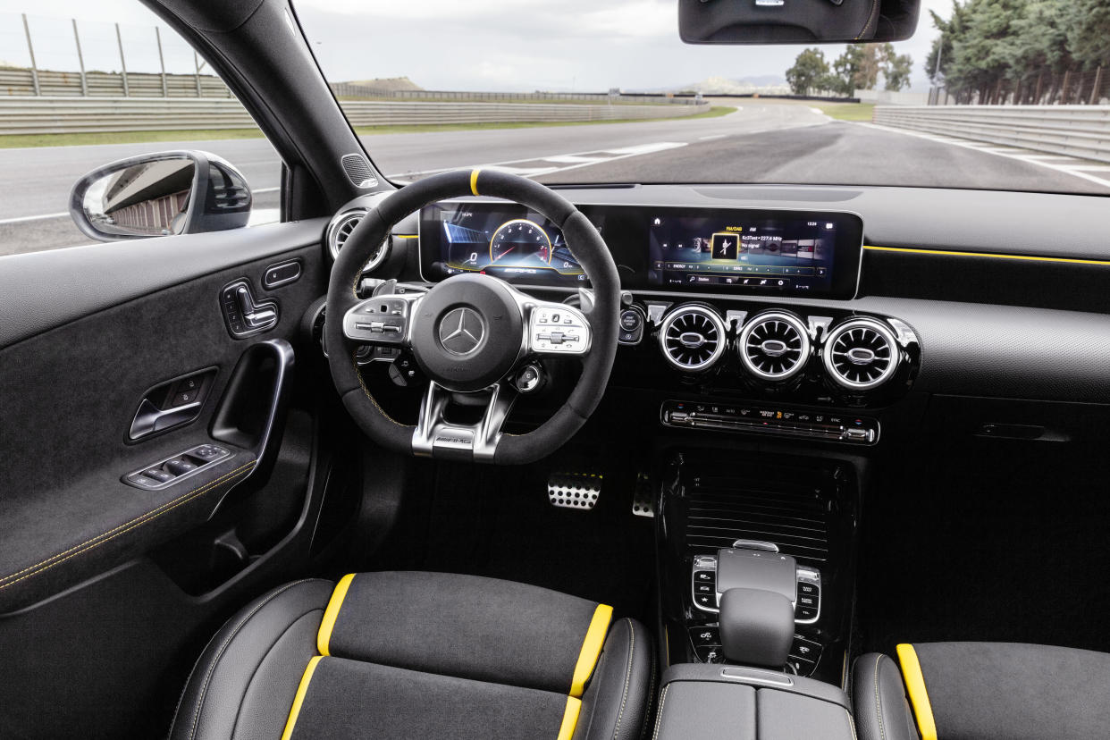 The interior features racing seats and matching steering wheel